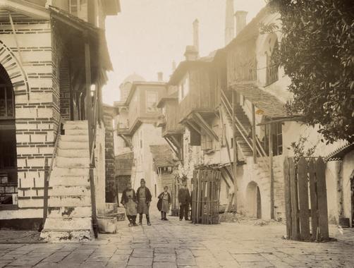 NG Vatopedi Monks walk on the stone streets of Vatopedi