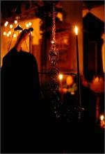 Lighting_a_candle_in_church