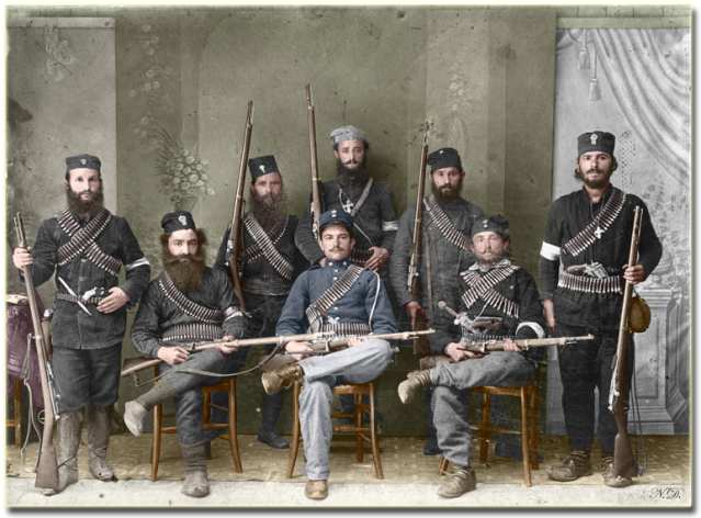 Monks1913  colourised photo above shows guards of a Greek monastery in Mount Athos after having repelled Bulgarian invaders (1913). Some are possibly monks and there is one Gendarme among them