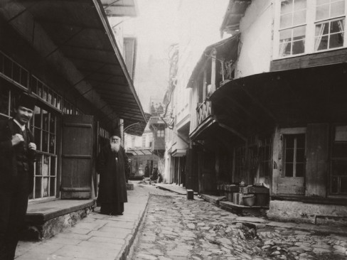 harry-griswold-dwight-locals-stand-outside-storefronts-and-houses-on-karyes-main-street-mount-athos-greece-1916