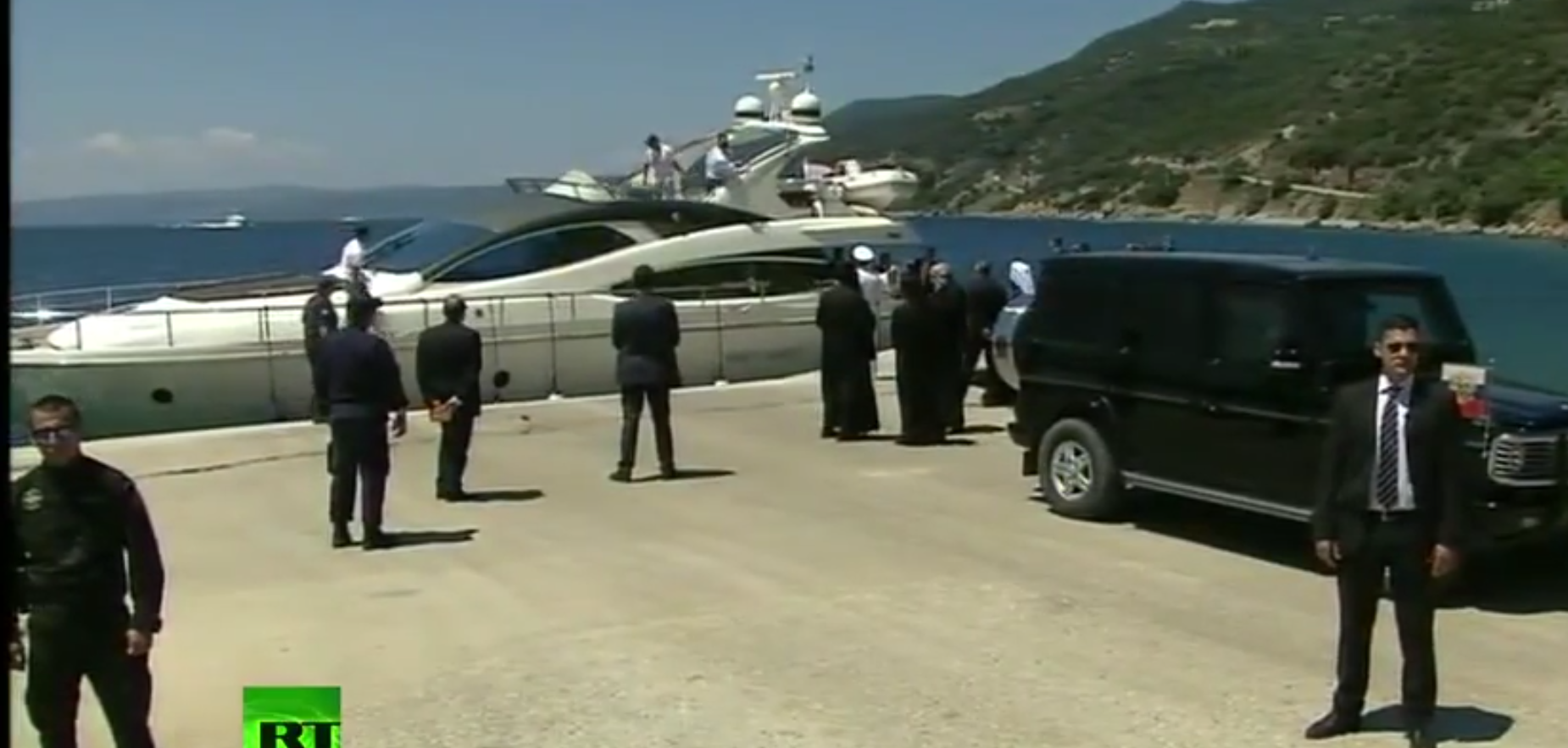 secret service with separate boat to Dafni in the background  Putins boat.